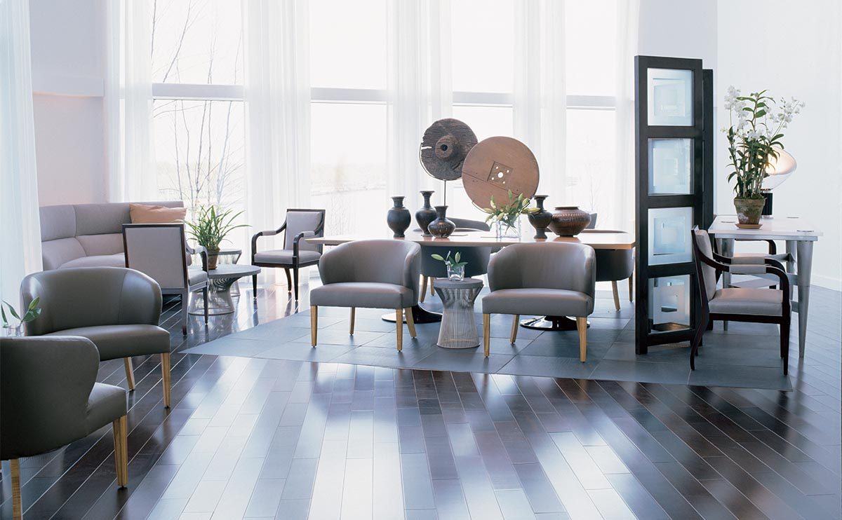 Clay tones, furniture, and a stone floor insert demarcate an intimate space.