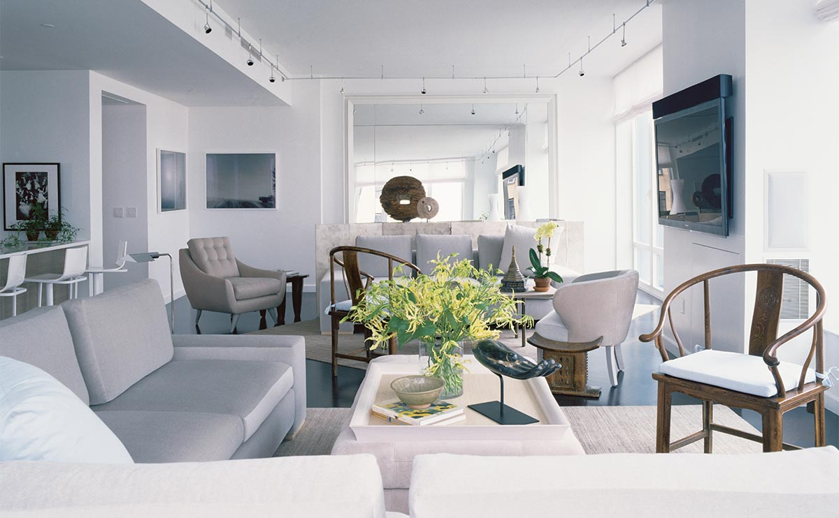 A palette of ethereal grays unifies two seating areas.